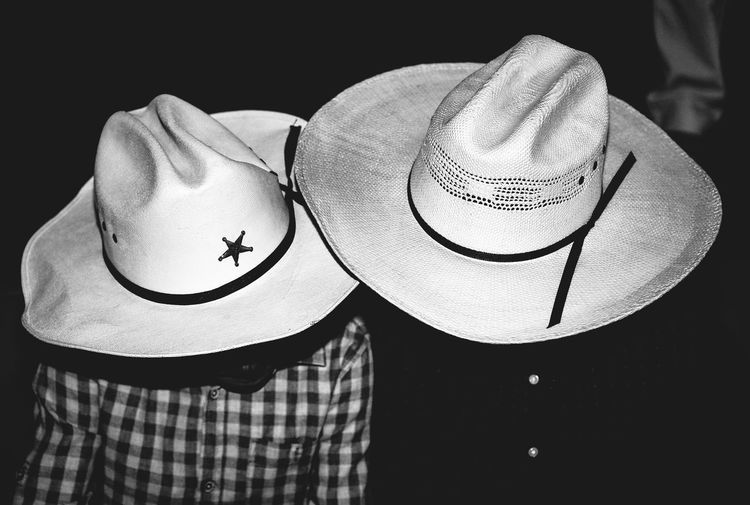 Close-Up Of People Wearing Cowboy Hats