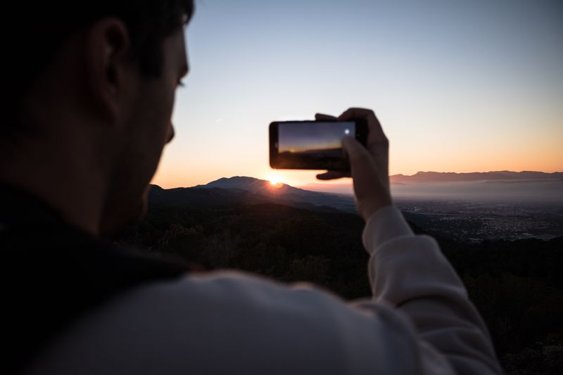 Photographing of the sunset Technology Photography Themes Sky Photographing Sunset Wireless Technology Activity One Person Communication Holding Leisure Activity Smart Phone Nature Camera Mobile Phone Portrait Portable Information Device Real People Camera - Photographic Equipment Headshot Capture Tomorrow