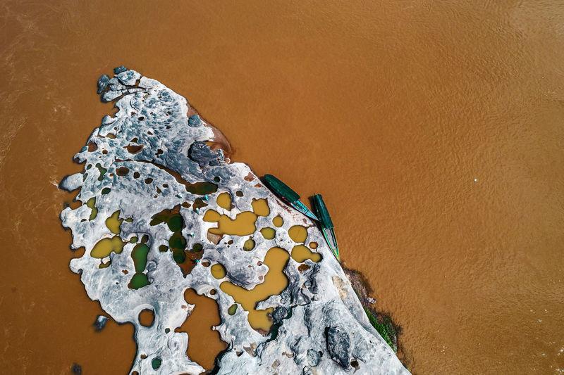 High angle view of rock on sand