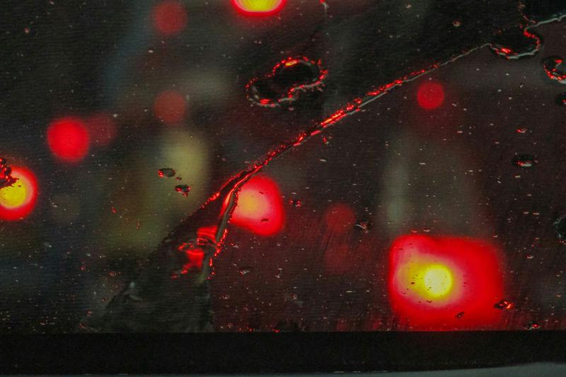 Close-up of illuminated red lights at night