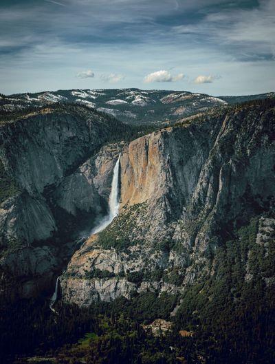 Scenic view of yosemite falls against sky