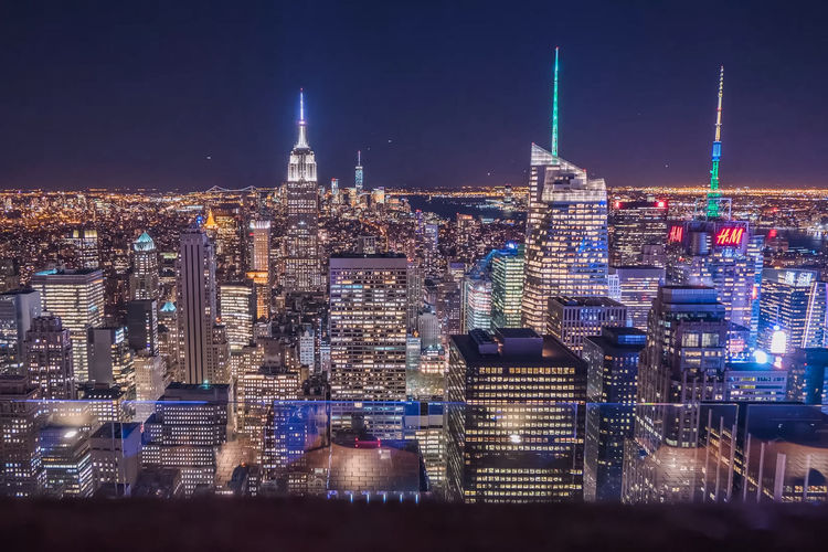 Empire State Building In Illuminated Cityscape At Night