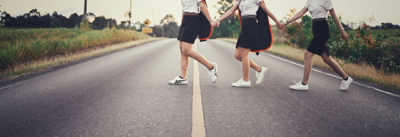 Low section of women running on road