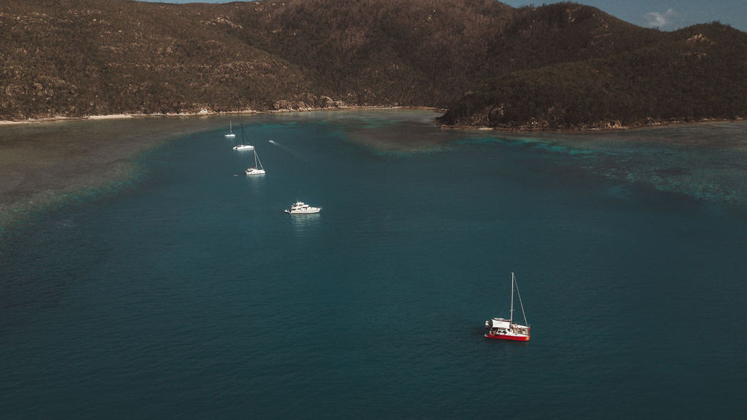 Drone  Aerial View Beauty In Nature Day Dronephotography High Angle View Mode Of Transport Moored Mountain Nature Nautical Vessel No People Outdoors Sailing Scenics Sea Sunlight Tranquil Scene Tranquility Transportation Tree Wake - Water Water Waterfront Whitsunday Islands