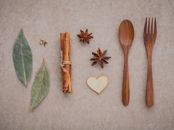 Directly above shot of star anise with cinnamon and wooden spoon