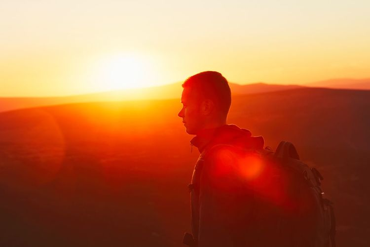 Amazing sunset. Silhouette of the young man on the mountain top. Adventure Golden Hour Hike Journey Landscape Leisure Activity Lens Flare Man Men Mountains Nature One Person Outdoors People Real People Scenics Silhouette Sun Sunlight Sunset Sunshine Tourism Tourist Travel Trip
