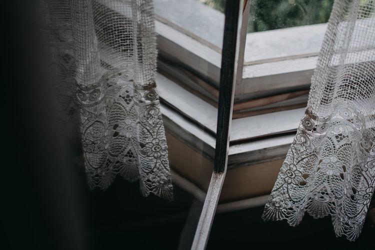 Curtain reflecting in glass window