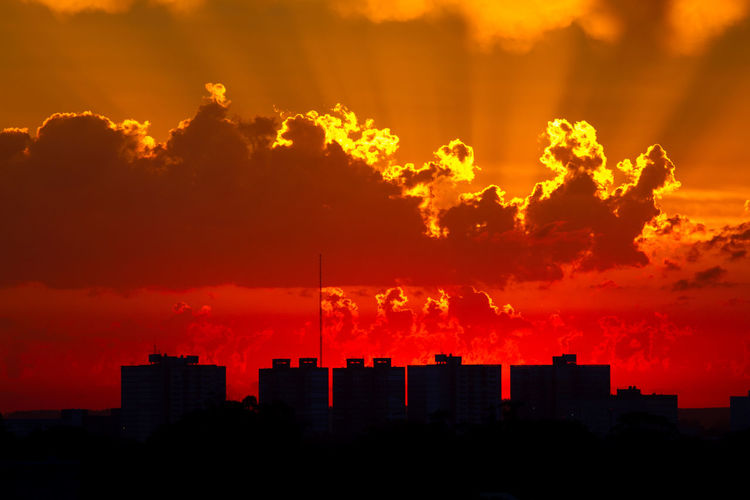 Silhouette Cityscape Against Sky During Sunset