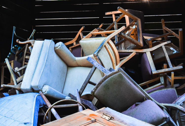 Abandoned chairs in junkyard