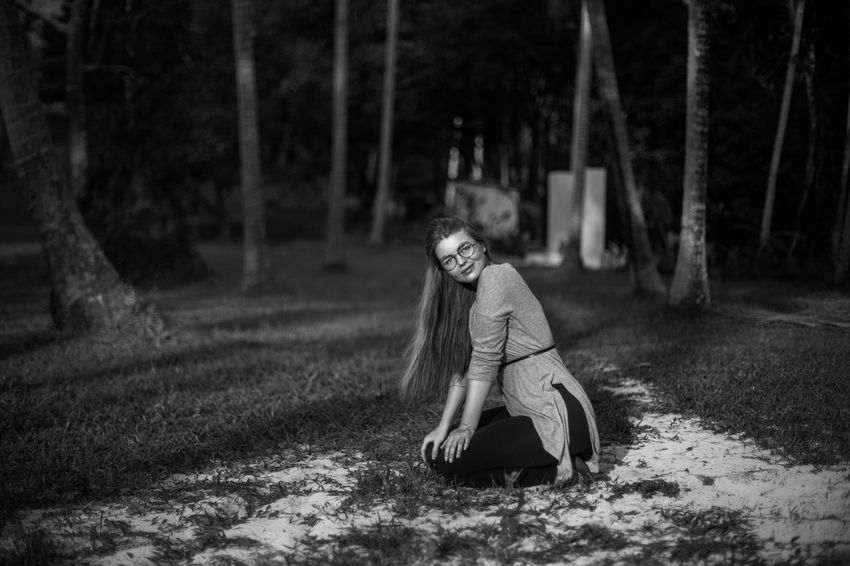 sitting in the forest after long way Beautiful Black & White Blackandwhite Blond Hair Childhood Day Forest Full Length Girl In The Forest Jungle Nature Nice One Girl Only One Person Outdoors People Portrait Pretty Round Glass Travel Destinations Tree Tropical Climate Woman Woman In Forest