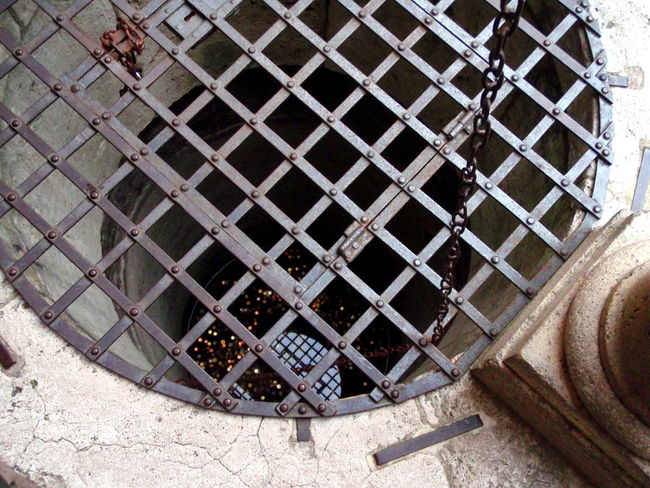 Chains Coins Day Fountain Geometric Shape Manhole  Manhole Lids Medieval Architecture Mesh No People Outdoors Protection