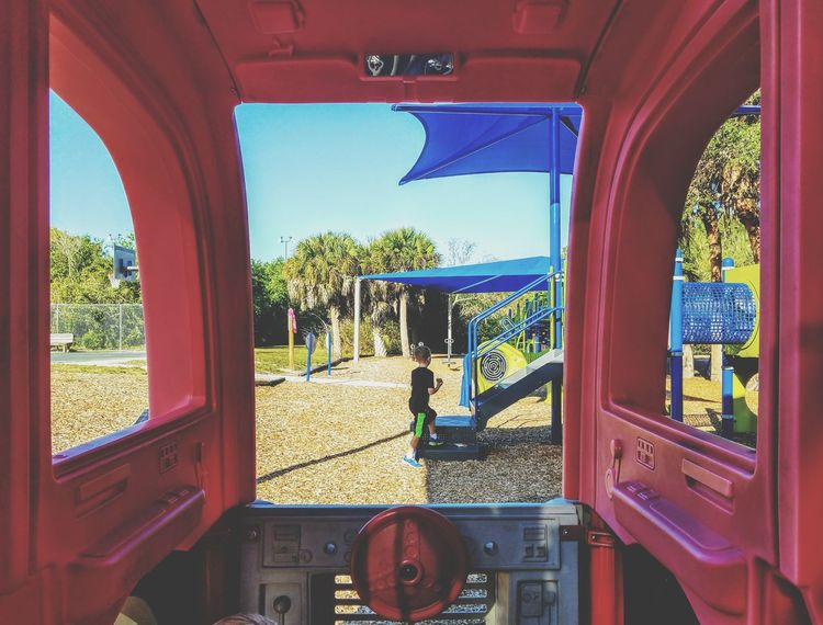 The Secret Spaces Blue Vehicle Interior Transportation Window Red Sky No People Day Close-up Outdoors Boy Boys Playing Childhood Child Children Only Playground BYOPaper!