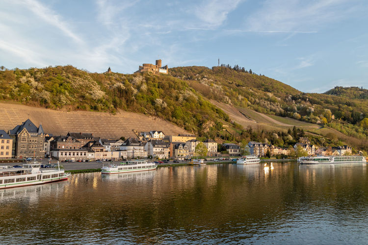 View at the city of bernkastel-kues at river moselle and mountains with vineyards