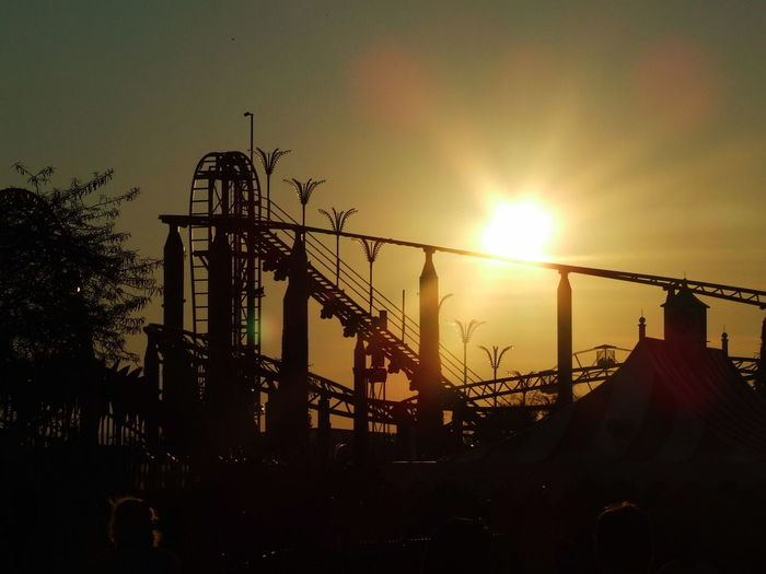 Low Angle View Of Silhouette Rollercoaster Against Sky During Sunset