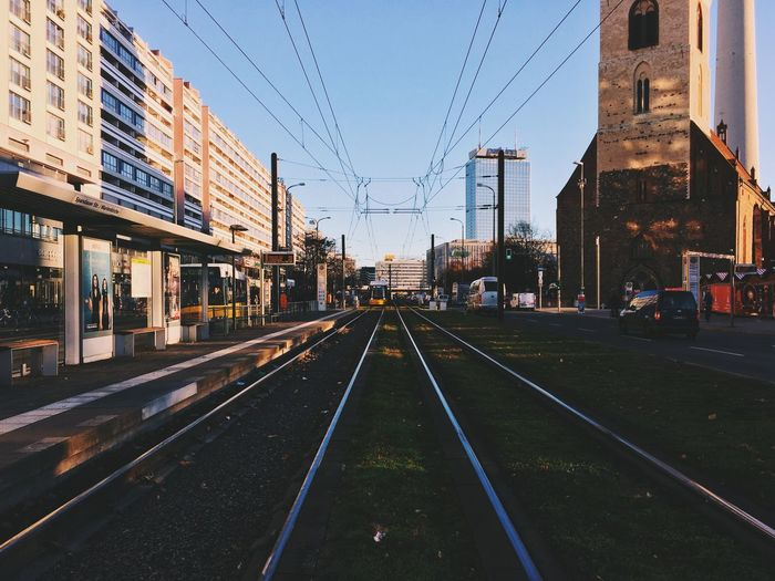 Alex in the morning. Alexn Architecture Berlin Berlin Photography Berliner Ansichten Building Exterior Built Structure Bvg Center City Day Land Vehicle Mitte Morning No People Outdoors Road Sky Sunrise Symmetry Tracks Train Tram Transportation TV Tower