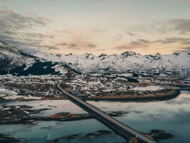 Norway Beauty In Nature Bridge Bridge - Man Made Structure Cloud - Sky Cold Temperature Lofoten Mode Of Transportation Mountain Mountain Range Nature No People Outdoors Scenics - Nature Sky Snow Snowcapped Mountain Sunset Tranquil Scene Tranquility Transportation Water Winter