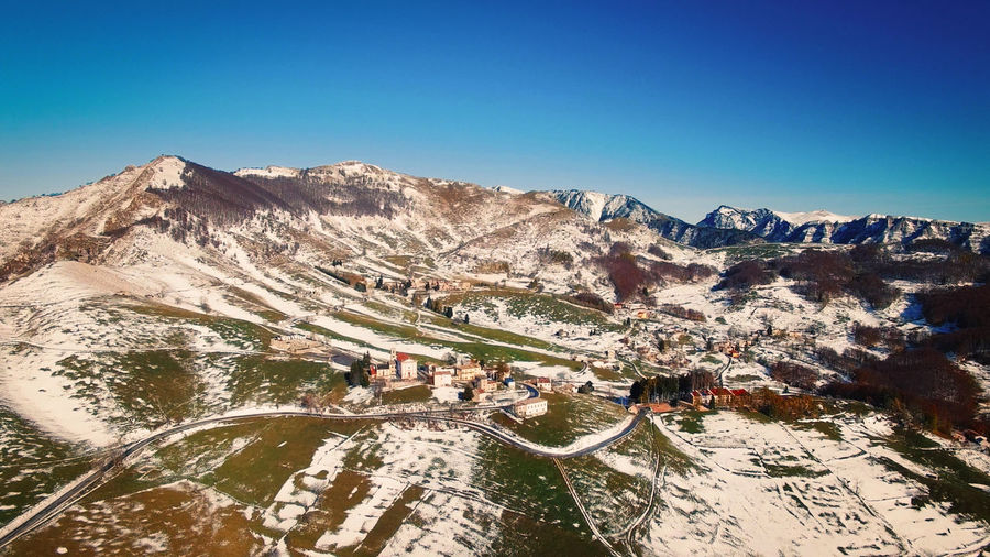 Winter italian village from the air view. Little beautyfull countryside. Campofontana Above Aerial Church Cold Day Elevated Estate Europe Forest Frost Hill Ice Landscape Light Mountain Nature Road Scenic Season  Snow Street Tourism Town Travel View Village White Winter