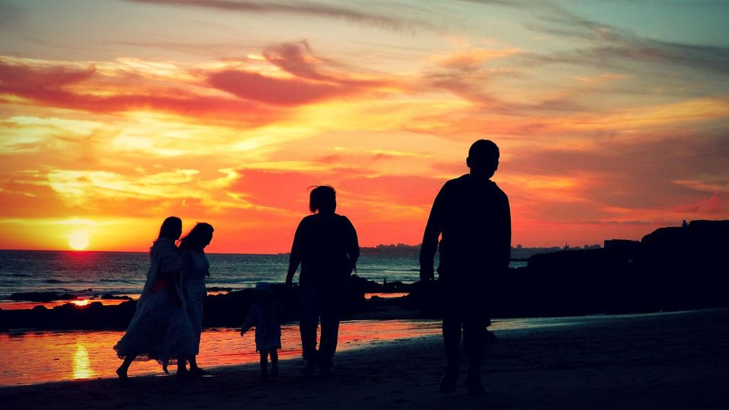 My family strolling on the beach Beauty In Nature Cloud Cloud - Sky Dramatic Sky Full Length Leisure Activity Lifestyles Men Nature Orange Color People Walking  Person Relaxation Romantic Sky People And Places Sea Shore Silhouette Sky Sunset Togetherness Tranquil Scene Walking On Beach Water Woman Live For The Story
