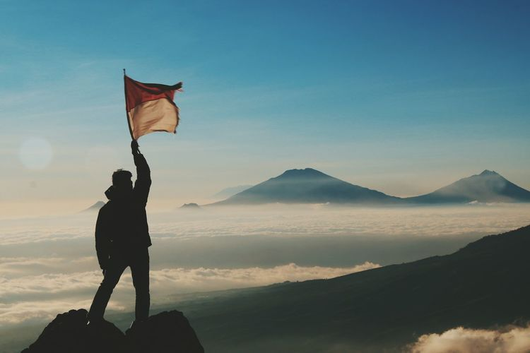 Nasionalisme.. One Person Adult Mountain Sky Adults Only One Man Only People Outdoors Day Only Men Nature INDONESIA Mix Yourself A Good Time Travel Photography Human Body Part EyeEmNewHere Nature Sunset Silhouette Arts Culture And Entertainment