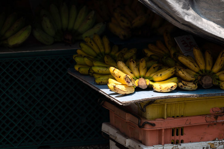 Banana Food And Drink Fruit Healthy Eating Food Freshness Wellbeing Tropical Fruit No People Yellow Day Pineapple For Sale Market Stall High Angle View Market Retail  Large Group Of Objects Outdoors Still Life Ripe