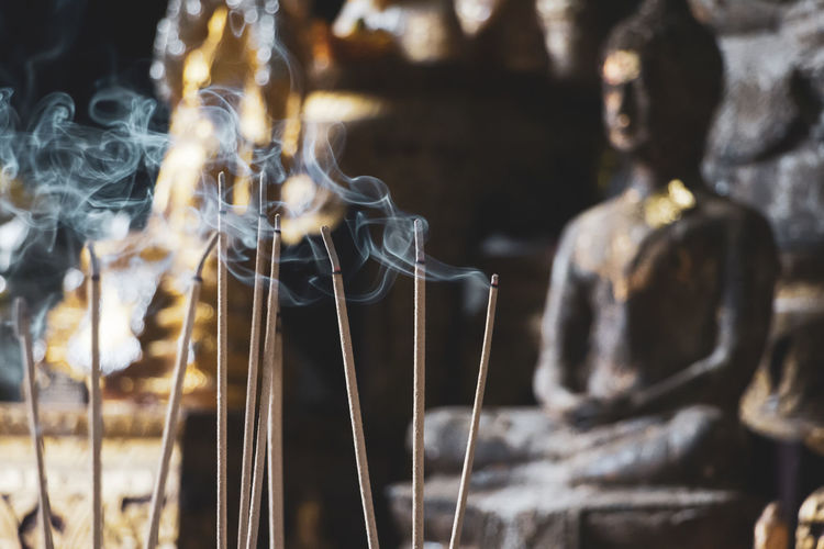 Holy smoke Buddha Smoke Art And Craft Belief Buddhism Buddhist Temple Focus On Foreground Human Representation Idol Incense Incense Burner Incense Sticks Jossstick No People Place Of Worship Religion Sculpture Spirituality Statue Temple EyeEmNewHere My Best Travel Photo A New Perspective On Life 2018 In One Photograph