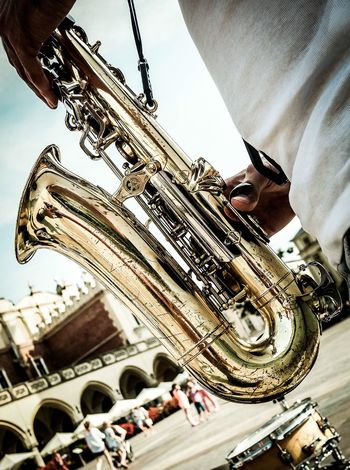 Music Musical Instrument Arts Culture And Entertainment Saxophone Musician Human Hand Performance Day Wind Instrument Men Real People Skill  Human Body Part Uniform Close-up One Man Only One Person Only Men People Shades Of Winter