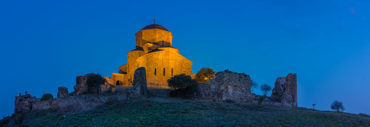 Jvari Church in Mtskheta, Georgia high resolution panorama at blue hour in the morning Blue Hour Christianity Church Cross Georgia High Resolution Jvari Jvari Monastery Light Lights Monastery Mtskheta Panorama Place Of Worship Ruins Stunning Trees Dawn Hill History Landscape Night No People Travel Destinations