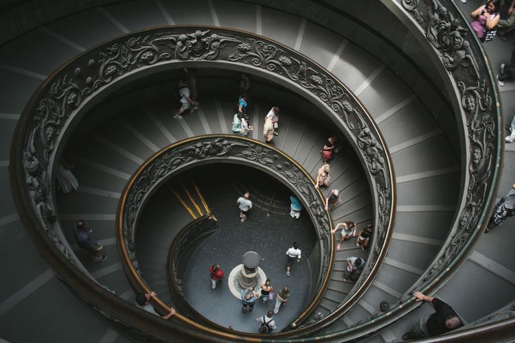 Tourist On Steps And Staircases At Vatican Museums