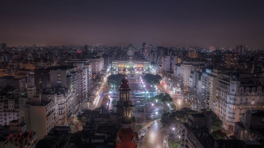 High angle view of palacio del congreso and buildings in city at night