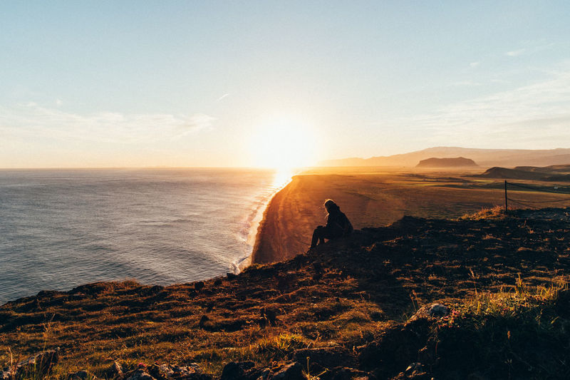 Dyrhólaey Iceland Beauty In Nature Black Sand Beach Day Horizon Over Water Landscape Mountain Nature One Person Outdoors People Real People Scenics Sea Silhouette Sky Sun Sunlight Sunset Tranquil Scene Tranquility Water Done That. Lost In The Landscape