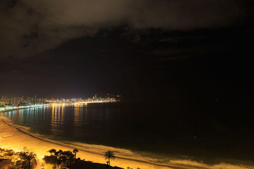 Beach City Cloud - Sky Illuminated Land Lighting Equipment Nature Night No People Outdoors Reflection Scenics - Nature Sea Sky Water
