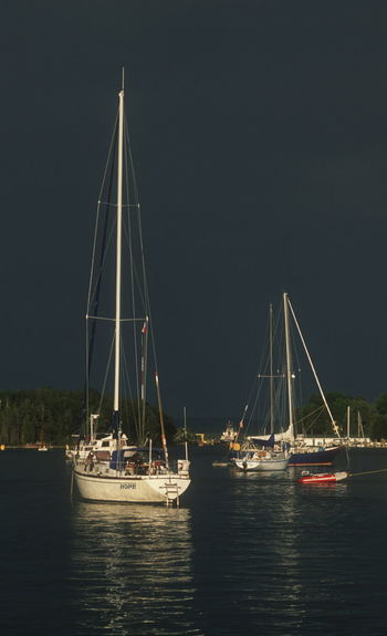Beauty In Nature Harbor Illuminated Mast Moon Moored Nature Nautical Vessel Night No People Outdoors Sailboat Sailing Sailing Ship Sea Sky Storm Clouds Water