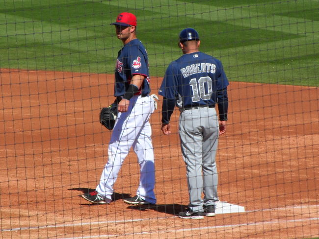Indians 1st baseman Nick Swisher and Padres 1st base coach, Dave Roberts. Baseball Goodyear Spring Training San Diego Padres