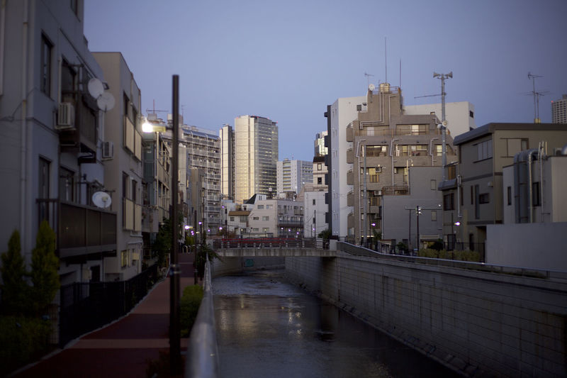 Japan Tokyo Architecture Building Building Exterior Built Structure Canal City Clear Sky Day Dusk Nature No People Office Building Exterior Outdoors Rain Reflection Residential District Sky Street Sunset Transportation Water Wet