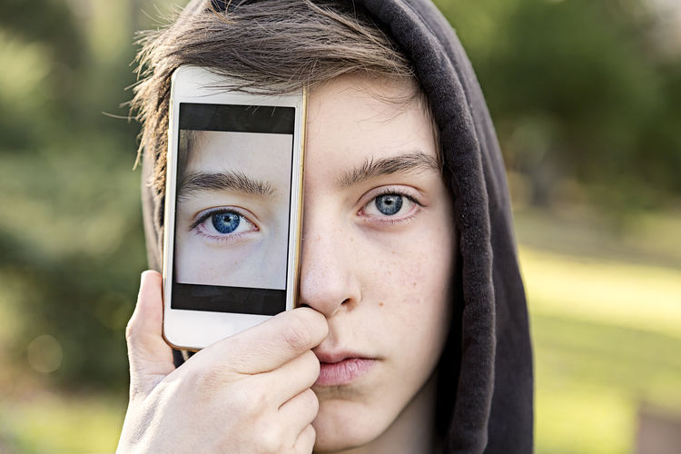 Close-Up Of Teenager Holding Phone