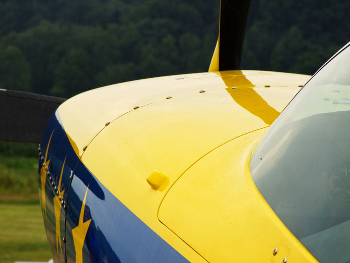 Close-up of yellow airplane