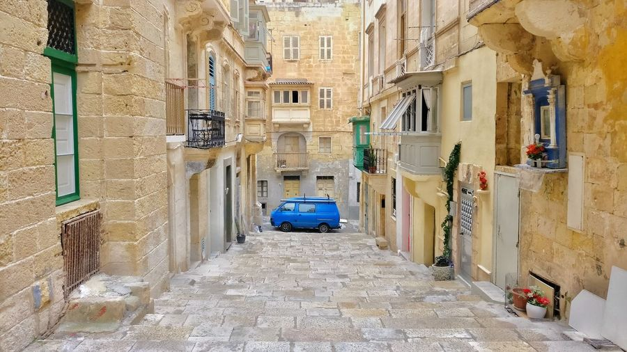 Blue Car in the old town of Valletta Blue Car Blue Car Old Town Backstreet Alleyways Alleyway Architecture Travelling Photography Travelling Malta♥ Malta Travel Photography Malta In My Eyes Cityscape Architecture Photography Architecture_collection Built Structure Travel Destinations Maltascapes Maltaphotography Valletta Valletta Architecture Mediterranean  Valletta Town