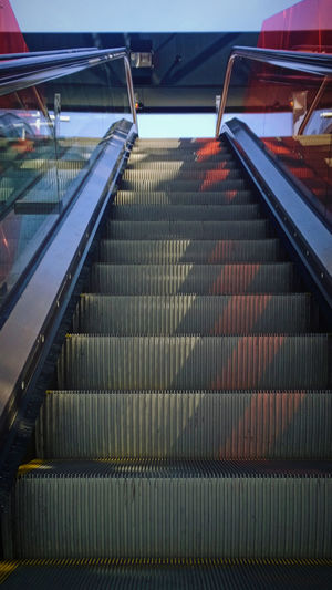 Escalators. Subway Architecture Built Structure Day Diminishing Perspective Escalator Eye4photography  EyeEm Gallery High Angle View Light And Shadow Low Angle View Metal Mode Of Transport Modern No People Railing Staircase Steps Steps And Staircases Structure Sunlight The Way Forward Transportation Underground Underground Station