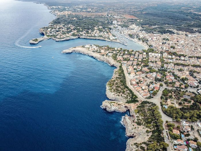 Drone  Mallorca SPAIN Aerial View Architecture Beauty In Nature Blue Building Exterior Built Structure City Cityscape Day High Angle View Landscape Nature No People Outdoors Scenics Sea Sky Travel Destinations Tree View Into Land Water Waterfront