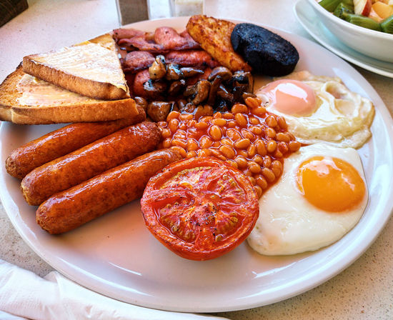 Traditional full english breakfast. Fried eggs, baked beans, bacon and toasts Baked Beans Cuisine Dish English Breakfast Fried Eggs Meal Served Bacon Baked Beans Close-up Delicious Food Fried Fried Egg Full Breakfast Main Course No People Plate Portion Prepared Food Ready-to-eat Sausage Serving Size Toasted Bread Traditional