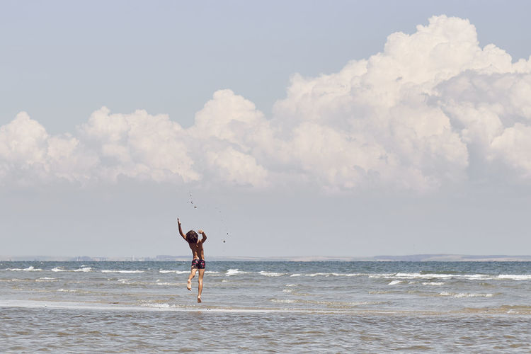 Arms Raised Beach Beauty In Nature Cloud - Sky Day Full Length Horizon Horizon Over Water Human Arm Jumping Land Leisure Activity Lifestyles Men Nature One Person Outdoors Real People Scenics - Nature Sea Sky Water