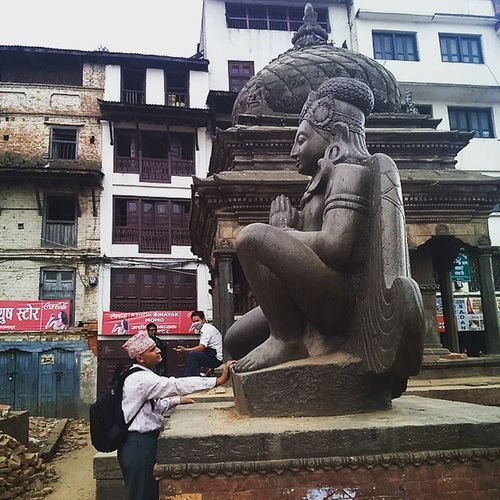 A passerby touches the idol and prays to it. The Garud which is in Basantapur stands strongly which was hit worst by the earthquake which measure 7.8 ricter scale destroyed almost all the monuments of Nepal. Rebuildingnepal Nepal EARTHQUAKES Basantapur Kathmandudurbarsquare