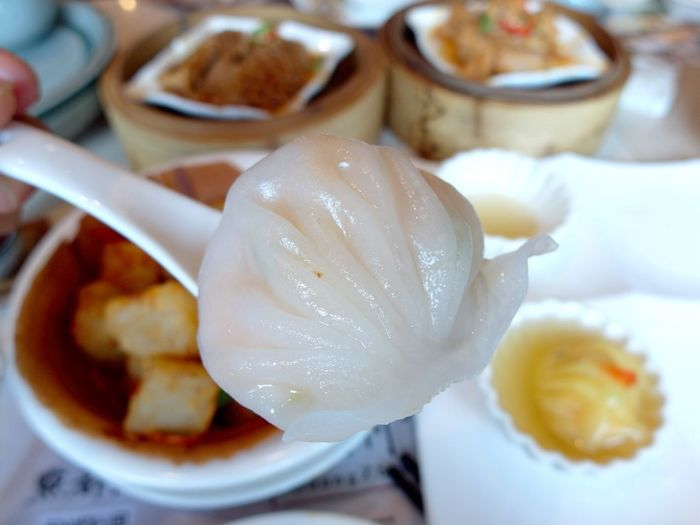 Close-up of shrimp dumpling on spoon at table