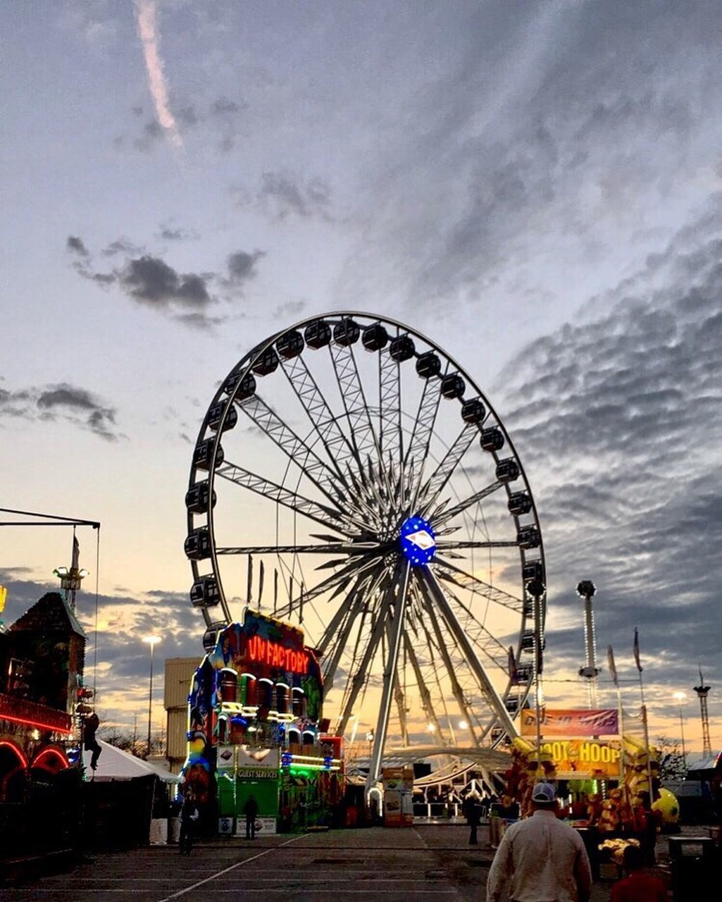 amusement park, arts culture and entertainment, ferris wheel, cloud - sky, amusement park ride, sky, leisure activity, big wheel, outdoors, low angle view, day, built structure, architecture, nature, no people, carousel
