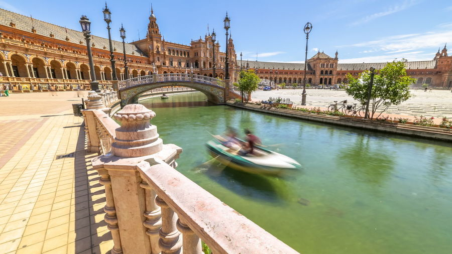 Daily boat trip at Plaza de Espana. River with boats and moving people in Seville, Andalusia, Spain Seville Seville Plaza De Espana Seville's Cathedral SevilleSpain Architecture Bridge Bridge - Man Made Structure Building Exterior Built Structure City Connection Day Fountian Mode Of Transportation Nature Nautical Vessel Outdoors River Seville Spain Plaza Seville, Spain Seville,spain Sky Spain ✈️🇪🇸 Tourism Transportation Travel Travel Destinations Water