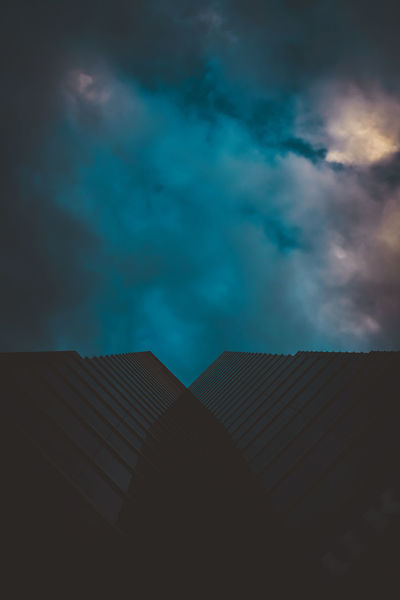 Sky Architecture Built Structure Cloud - Sky Building Exterior Low Angle View Nature Building No People Roof Outdoors Overcast Day City Residential District Pattern Storm Cloud Sunlight Corrugated
