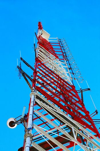 Low Angle View Of Antenna Tower Against Clear Blue Sky