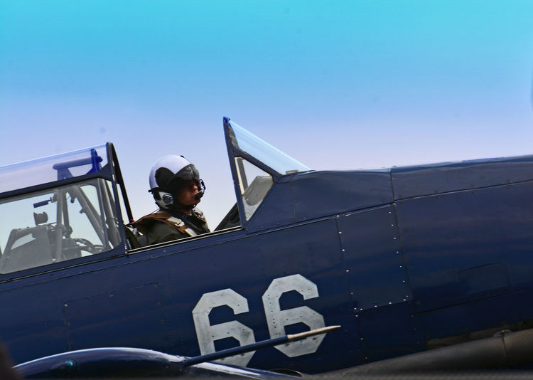 People Real People Men Airplane Sky Blue Day Outdoors Helmet Transportation Pilot Clear Sky Headwear Cockpit Uniform Occupation Mode Of Transport Young Adult One Person Low Angle View World War I Nautical Vessel Air Vehicle Military Uniform Aircraft Cockpit Aircraft Pilot Go Higher