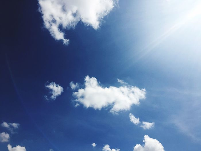 Sky Blue Low Angle View Sunbeam Beauty In Nature Nature Cloud - Sky Sunlight Day Sun No People Backgrounds Sky Only Scenics Outdoors Tranquility