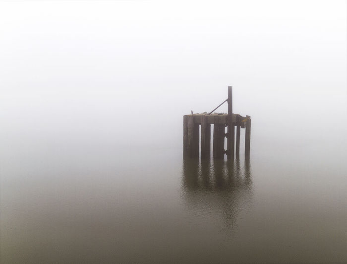 Lost in the fog Built Structure Copy Space Day Fog Hazy  Metal Nature No People Reflection Silhouette Still Life Studio Shot Table Tranquility Water Waterfront Wood - Material